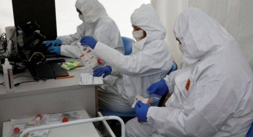 People wearing protective coverall work at the drive-thru testing centre on the coronavirus disease (COVID-19) in Warsaw